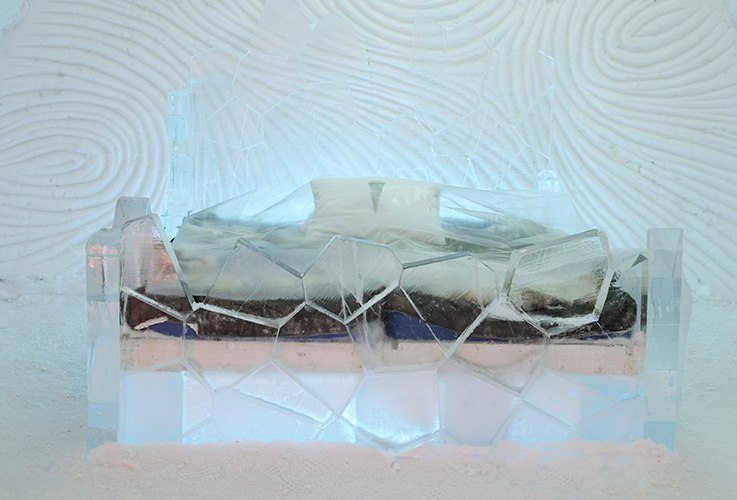 Bed in a frozen hotel room