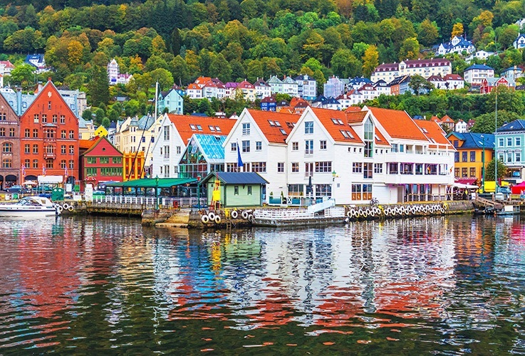 Red roofed buildings overlooking water