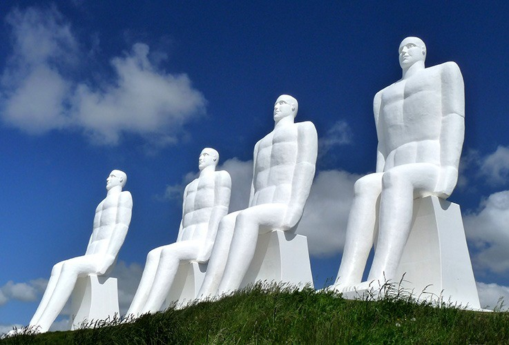 Row of large statues of men